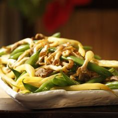 Ingredients:    1 pound  green beans, trimmed  1 pound  yellow wax beans, trimmed  3 tablespoons  extra-virgin olive oil  2 cloves  garlic, minced  8 ounces  wild mushrooms, such as chanterelle, oyster or porcini, trimmed and sliced (see Substitution Note)  1/2 teaspoon  kosher salt, divided    Fre