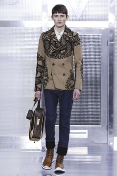 At Louis Vuitton designer Kim Jones produced a love letter of a menswear show. He tilted, dedicated and incorporated the artist Christopher Nemeth's work into every inch of his fall/winter 2015 col...