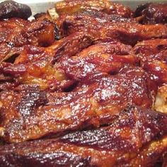 CROCK POT RIBS: Ribs, 2 cups bbq sauce plus extra to brush, 1 cup ketchup