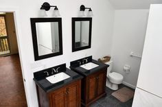 Side-by-side cabinet sinks in master bathroom