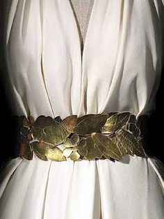 A bias-cut crêpe dress with a gilded-leaf belt ~ ca. 1936