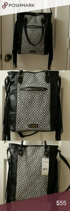 Bag New Black and white print cross body / tote bag  One exterior pocket Inside dot lining One interior zip pocket and two pouch pockets  14 high by 12 width  8 for the handles strap 25 for the shoulder strap Madden Girl Bags