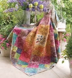 """""""Fleur Delight Throw"""" from Hop To It! by Edyta Sitar for Laundry Basket Quilts. Quilting star Edyta Sitar combines patchwork patterns with applique stitching in the quilting projects in Hop To It! Find it online: http://landauerpub.com/Hop-To-It-HURT.html"""