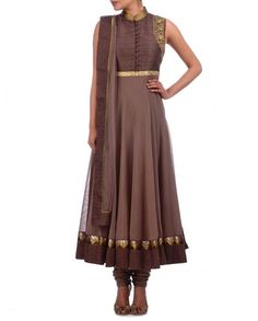 This chocolate color long anarkali suit is in net fabric having pure raw silk yoke. Yoke part of this anarkali suit is embellished with golden handwork and chocolate fabric buttons on front. This anarkali suit comes with a matching churidar and dupatta. Designer Salwar Kameez, Designer Anarkali, Long Anarkali, Anarkali Dress, Anarkali Suits, Punjabi Suits, India Fashion, Ethnic Fashion, Asian Fashion