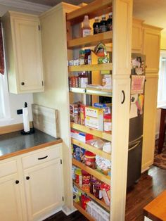 A concealed, pull-out pantry with access from two sides maximizes space and keeps ingredients close at hand in this hardworking kitchen redo.   thisoldhouse.com
