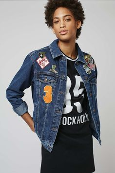 Chanel ultimate '90s vibes in this MOTO badged denim jacket. In an oversized fit, it features scattered badge details to the front and back and is finished with a button down placket and pockets. 100% Cotton. Machine wash.