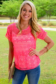 """If you're in a race against the clock, just throw this hot neon top over a cami and head on out the door! The lace design is super trendy and so eeeeeasy for summertime! :) Fits true to size. Kristen is wearing the small. From shoulder to hem: S- 24"""" M- 24.5"""" L- 25"""""""