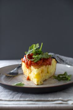 Spanish Omelet with Marcella Hazan's Butter Tomato Sauce by flourishingfoodie #Eggs #Omelet #Spanish #Potato #Onions #Cheese