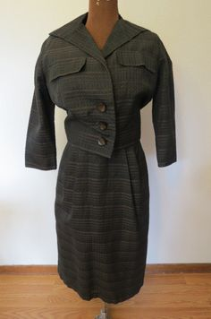 Check out this item in my Etsy shop https://www.etsy.com/listing/461978448/vintage-1950s-paul-sachs-black-and-brown