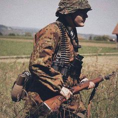 A Wehrmacht soldier marches through a field on the Eastern front He carries his standard issue and ammo for an Ww2 Uniforms, German Uniforms, German Soldiers Ww2, German Army, Luftwaffe, Military Art, Military History, Germany Ww2, Ww2 History