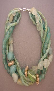 Dorje Designs; the effect of seaglass  Interesting use of large-holed beads, with small strands weaving in and out.