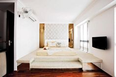 The platform is not only a frame for the bed, it hides storage for the home owners.