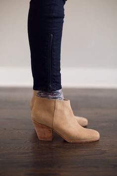 Fall outfit with a little bit of grit. I'm not a hat person myself, but I love it on Candice here. Ankle jeans and booties are a perfect combination. Cute floral peekaboo socks tie it all tog…