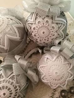 Beautiful Christmas ball ornaments using a 10cm styrofoam ball quilted with shimmering silver, white and grey satin fabric. In these ornaments I also used two small white handmade crochet doilies on both sides of the baubles to make it even more special. I crafted these ornaments