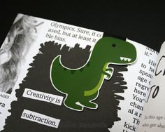 You will have the Jurassickest bookmark in the whole library. He may have little arms, but he can manage any pages you throw at him. He'll sink his teeth into the densest textbooks and there is no tal