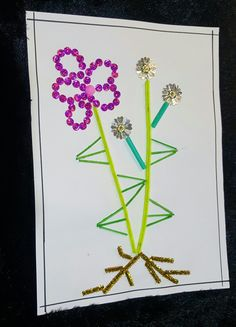 Craft. Plant made out of beads, matchsticks, brush cleaner .