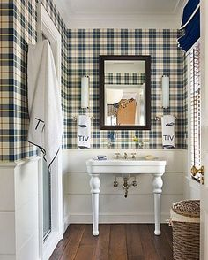 Love this tartan boys bathroom. White wainscotting keeps the tartan on the top half of the wall and prevents it from being too overwhelming.
