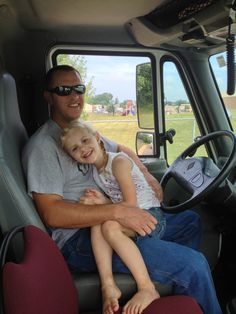 Reese with favorite lineman!!! Waiting to drive in the 4th of July parade 2013