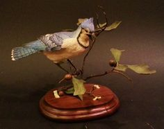 Painted Blue Jay wood carving by Jim Harden, offered for sale by Ditto Galleries. www.dittogalleries.com