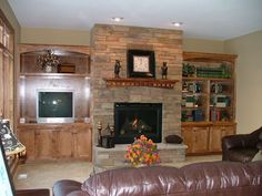 LDK Living room with 2 custom wood built-ins and stone fireplace