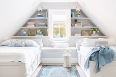 Alyssa Rosenehck – Raquel Garcia Design – Shared bedroom design features white wood twin beds in a sloped ceiling attic room against a window and wall with built-in shelves and bench. Attic Renovation, Attic Remodel, Bedroom Minimalist, Slanted Walls, Slanted Wall Bedroom, Sloped Ceiling Bedroom, Attic Bedrooms, Attic Bedroom Kids, Bedroom Small