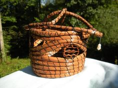 Long leaf pine needles basketry dates back to Seminole Indian culture from Florida Everglades and the Coushatta Indians from Alabama.  I make my baskets by using the old coiling method, binding the bundles of pine needles with strong thread, integrating sliced black walnut shells and other decorations, then shellacking finished baskets for luster and durability.  My baskets and pine needle sculptures have won many blue ribbons and prizes in prestigious, jurried art shows.    This baskets…