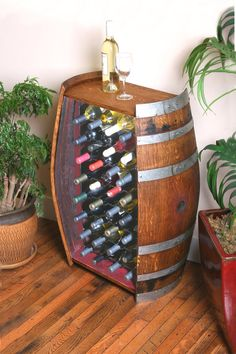 The 32 bottle wine barrel cabinet is perfect for lots of storage in a small space. You have the barrel head top as a tasting/serving table that still shows off the cooperage markings on top of the barrel. Barris, Wine Barrel Furniture, Serving Table, Wine Cabinets, Oak Cabinets, Wine Storage, Wood Projects, Diy Furniture, Decoration