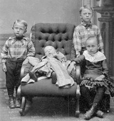 While we think of having our children's picture taken with a deceased sibling a bit disturbing, it was not an uncommon practice. This was likely the only photograph they would ever have of, not only the deceased child, but of all of the children together.