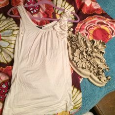 White floral top White sleeveless top with flowers on left arm opening. Sylvia and Mado Tops Camisoles
