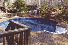 Freedom above ground pool installed completely above ground will full wood deck, stairs, and hand rail.