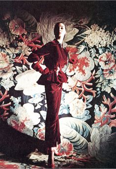 1949 Betty Threatt in ruby-red silk velvet dinner-suit by Christian Dior. The skirt is bone-narrow with a strapped ruby satin top, the jacket, bloused with flaring hips...at the waist, Cartier's jeweled parakeets, red sandals by I.Miller, Ohan Berberyan carpet, the perfume, naturally, would be Dior's 'Diorama'.