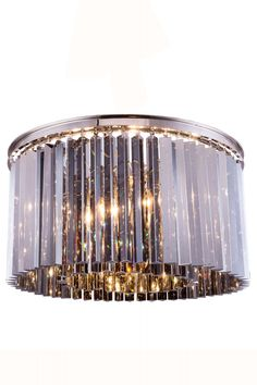 """Sydney Flush Mount D:26"""" H:13.5"""" Lt:8 Polished nickel Finish (Royal Cut Silver Shade. Crystal bars in clear or rich and vibrant hues of gold or silver exploding with prisms layered in circular or rectangular shapes. The Sydney will satisfy your desire to hold the past and embrace the future at the same time.Specifications:   Dimensions 26"""" W x 13.5"""" H   Finish Polished nickel    Crystal Trim  Royal Cut    Crystal Color  Silver Shade (Grey)    Chain/Wire Included  10""""    Light Bulbs  8…"""