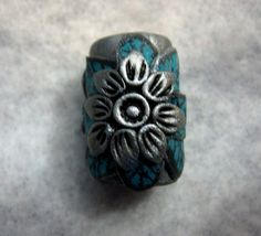 Hey, I found this really awesome Etsy listing at http://www.etsy.com/listing/90035394/dread-bead-silver-flower-with-turquoise