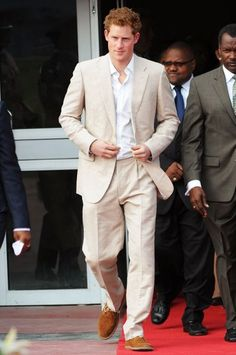 PRINCE HARRY  In a lightweight suit and Russell & Bromley desert boots at a youth rally in the Bahamas.