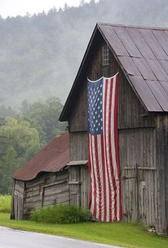 US flag on old wooden barn
