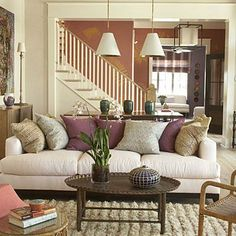 When adding fall color, orange is not your only option. Jewel tones of deep purple, magenta, and even dark teal can go a long way in warming up a space. Coastalliving.com