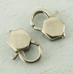 Medium Stainless Steel Lobster Clasp - Unique Geometric Style - Sturdy and Shiny Clasps - 12mm X 8mm. $4.00, via Etsy.