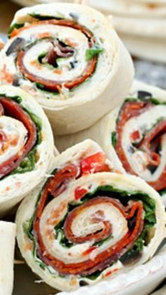 Italian Sub Sandwich Tortilla Pinwheels Italian Sub Sandwich Tortilla Pinwheels ~ These tasty tortilla roll-ups start with a cream cheese spread that's loaded with garlic, onions, olives, cheese, peppers and Italian seasoning. Tortilla Pinwheels, Tortilla Rolls, Tortilla Roll Ups Appetizers, Roll Ups Tortilla, Healthy Tortilla Wraps, Mexican Pinwheels, Cream Cheese Pinwheels, Veggie Wraps, Veggie Food