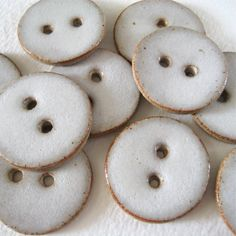 Handmade ceramic buttons in stoneware clay and glazed with a gloss white glaze…