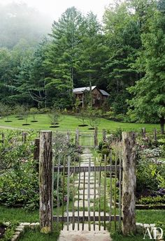 The cutting garden at a Tennessee compound is filled with both perennials and annuals; it was designed by landscape architect Mary Palmer Dargan. Beyond it are a newly planted apple orchard and, nestled at the edge of the woods, the Writer's Cottage | archdigest.com