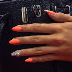 Orange almond-shaped nails. These don't look too long or scary, surprisingly.