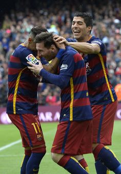 Barcelona's Argentinian forward Lionel Messi (C) celebrates with Barcelona's Brazilian forward Neymar ans Barcelona's Uruguayan forward Luis Suarez (R) after scoring a goal during the Spanish league football match FC Barcelona vs RCD Espanyol at the Camp Nou stadium in Barcelona on May 8, 2016.