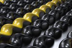 black and yellow plastic spiral sticks on black background