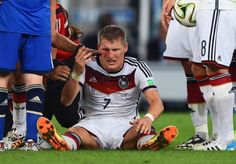 Germany v Argentina: 2014 FIFA World Cup Brazil Final RIO DE JANEIRO, BRAZIL - JULY 13: Bastian Schweinsteiger of Germany receives treatment after a collision during the 2014 FIFA World Cup Brazil Final match between Germany and Argentina at Maracana on July 13, 2014 in Rio de Janeiro, Brazil. (Photo by Matthias Hangst/Getty Images)