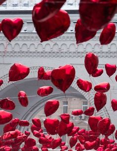 { Red heart balloons }