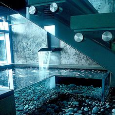 This is a water feature in a home!! It would make an awesome spa tub or an awesome fish tank.