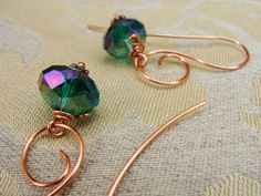 Scrolled Copper Wire Earrings with  Wire Wrapped Teal Crystals. $15.00, via Etsy.