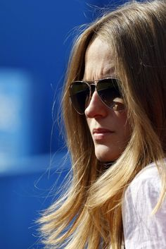 Kim Sears, girlfriend of Andy Murray of Britain, watches the match between Murray and Nicolas Mahut of France during their men's singles tennis match at the Queen's Club tournament in London June 13, 2012.