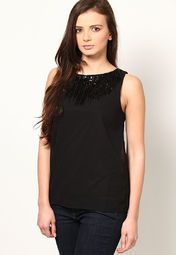 Increase your glam quotient wearing this black coloured top from the house of ONLY. Made of 100% polyester, this top for women is quite comfortable to wear. Featuring a slim fit, this classic top is ideal to be worn to parties.