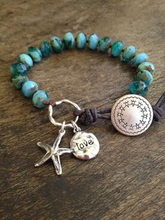 This beautiful bracelet features turquoise opal Czech beads hand knotted with dark brown nylon cord featuring an artisan silver starfish and